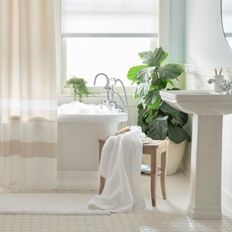 Bathroom Bliss Luxurious towels and pretty accessories  make every day a spa day.