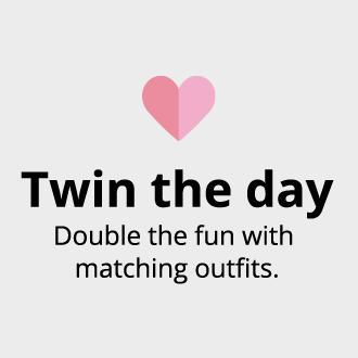 Twin the day. Double the fun with matching outfits.